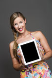 Pretty woman holding a blank tablet-pc Royalty Free Stock Image