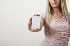Pretty woman holding a blank white sign Stock Photos