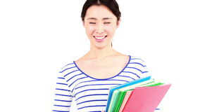 Pretty woman holding books and smiling at the camera stock footage
