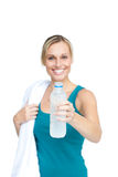 Pretty woman holding a bottle of water and a towel Royalty Free Stock Photo