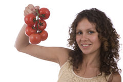 Pretty woman holding branch of red tomatoes Royalty Free Stock Photos
