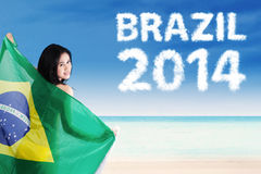 Pretty woman holding brazilian flag Stock Image