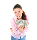 Pretty woman holding a bunch of money. Isolated on white background royalty free stock photography