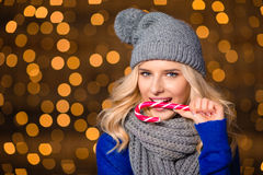 Pretty woman holding candy can Stock Photos