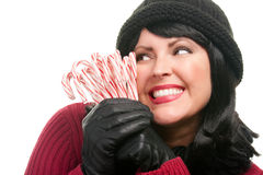 Pretty Woman Holding Candy Canes royalty free stock photography