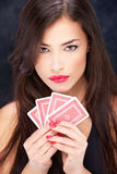 Pretty woman holding cards. Pretty long hair woman holding cards Stock Image