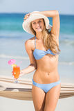 Pretty woman holding cocktail Royalty Free Stock Images