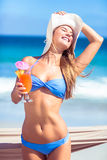 Pretty woman holding cocktail Royalty Free Stock Image