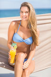 Pretty woman holding cocktail in the hammock Royalty Free Stock Photos