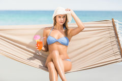 Pretty woman holding cocktail in the hammock Stock Image