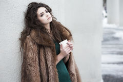 Breaktime. Attractive Thoughtful Woman holding Coffee Cup and Relaxing Royalty Free Stock Image