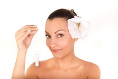 Pretty woman holding cotton hygienic tampon Stock Image