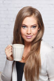 Pretty woman holding a cup of drink Royalty Free Stock Image