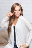 Pretty woman holding fake eyelashes Stock Photo