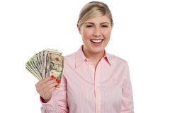 Pretty woman holding fan made of money Royalty Free Stock Image
