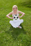 Pretty woman holding a football Stock Photo