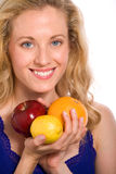 Pretty Woman Holding Fruits. Attractive Blond Lady Holding an Apple, Lemon and Orange Royalty Free Stock Photos