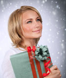 Pretty woman holding gift box Royalty Free Stock Photo