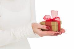 Pretty woman holding gild gift Royalty Free Stock Photos