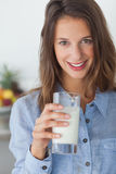 Pretty woman holding a glass of milk Stock Image