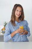Pretty woman holding a glass of orange juice Royalty Free Stock Photography