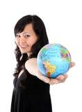 Pretty Woman Holding Globe royalty free stock photography