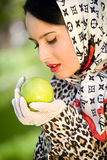 Pretty woman holding green apple Stock Photo