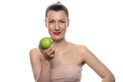 Pretty Woman Holding Green Apple Against White Stock Images