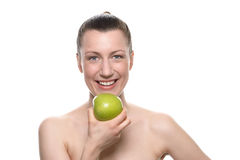Pretty Woman Holding Green Apple Against White Royalty Free Stock Photos