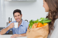 Pretty woman holding groceries bag Stock Photography