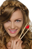 Pretty woman holding heart with chopsticks Royalty Free Stock Image