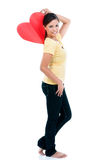 Pretty Woman Holding Heart Sign Royalty Free Stock Photography