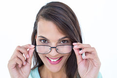 Pretty woman holding her eyeglasses Stock Images