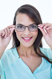 Pretty woman holding her eyeglasses Stock Image