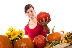 Pretty woman is holding an hokkaido pumpkin Royalty Free Stock Photo