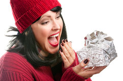 Pretty Woman Holding Holiday Gift Stock Photo