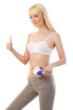 Pretty woman holding massager and giving thumbs up Stock Photo