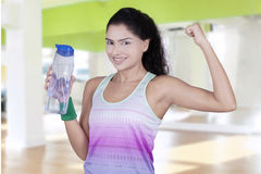 Pretty woman holding mineral water at gym Stock Image