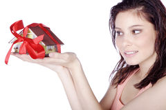 Pretty woman holding a miniature house Royalty Free Stock Photography