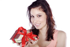 Pretty woman holding a miniature house Stock Photography