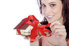 Pretty woman holding a miniature house Royalty Free Stock Images