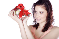 Pretty woman holding a miniature house Royalty Free Stock Image