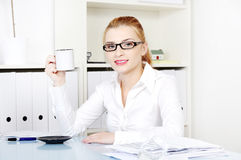 Pretty woman holding mug in her hand. Royalty Free Stock Images