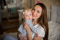 Pretty woman holding a newborn baby girl in her arms stock image