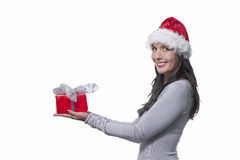 Pretty woman holding out a gift Royalty Free Stock Photo