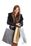 Pretty woman holding paper bags Stock Photography