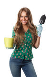 Pretty woman holding a pot and a mini spade Stock Photography