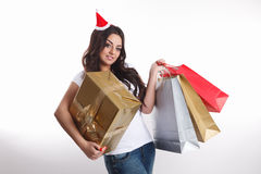 Pretty woman holding presents Stock Photos