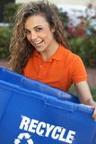 Pretty woman holding recycle bin smiling Royalty Free Stock Image