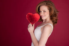 Pretty Woman Holding Red Heart Stock Photography